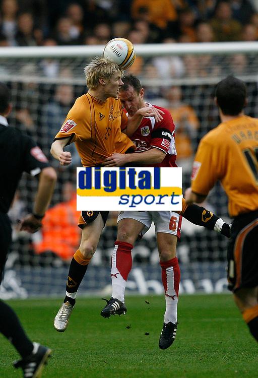 Photo: Steve Bond/Sportsbeat Images.<br />Wolverhampton Wanderers v Bristol City. Coca Cola Championship. 03/11/2007. Andy Keogh (L) tries to turn the ball past Louis Carey (C)