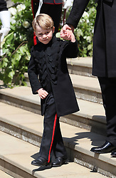 Prince George on the steps of St George's Chapel in Windsor Castle after the wedding of Prince Harry and Meghan Markle.