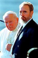 Fidel Castro with Pope John Paul II at the Jose Marti Airport in Havanna Cuba, January 21, 1998.