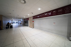 Edinburgh, Scotland, UK. 27 March, 2020. Interior views of a deserted Edinburgh Airport during the coronavirus pandemic. With very few flights during the current Covid-19 crisis passengers are scarce in the terminal building. Shops in arrivals area all closed.  Iain Masterton/Alamy Live News