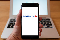 Using iPhone smartphone to display logo of Bank of America the American multinational banking and financial services corporation
