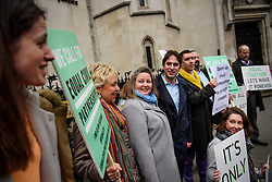 © Licensed to London News Pictures. 21/02/2017. London, UK. Heterosexual couple REBECCA STEINFELD (3L) and CHARLES KEIDAN  (4L) stand with campaigners as they arrive at Royal Courts of Justice in London, where a Court of Appeal ruling is due on whether a heterosexual couple can have a civil partnership. Photo credit: Ben Cawthra/LNP