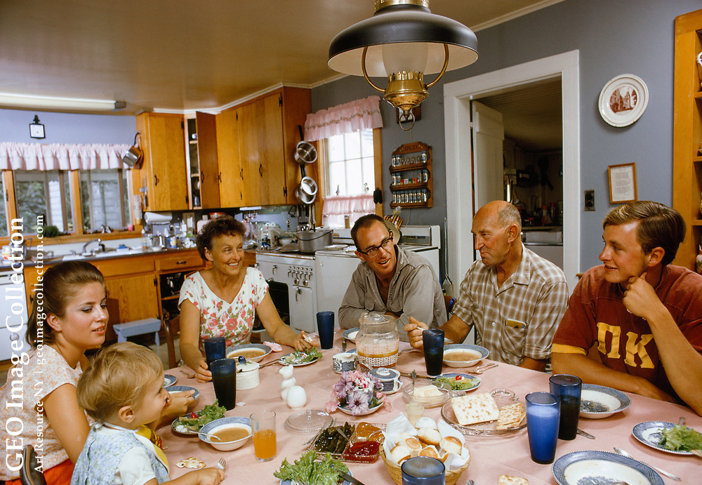 A farming family sits down for a meal and conversation.