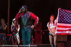 Calvin KB Bishop singing the national anthem on stage at Westworld on Thursday of Arizona Bike Week 2014. USA. April 4, 2014.  Photography ©2014 Michael Lichter.