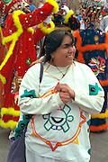 Parade participant age 27 having fun Cinco de Mayo parade.  St Paul Minnesota USA
