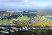 Nederland, Noord-Brabant, Eindhoven, 24-10-2013; Knooppunt Ekkersweijer, kruising A50 met A2 (naar horizon, ri Den Bosch).<br /> Ringroad Eindhoven, Ekkersweijer Junction<br /> luchtfoto (toeslag op standaard tarieven);<br /> aerial photo (additional fee required);<br /> copyright foto/photo Siebe Swart.