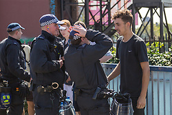 London, August 27 2017. Police search young revellers as they arrive as Family Day of the Notting Hill Carnival gets underway. The Notting Hill Carnival is Europe's biggest street party held over two days of the bank holiday weekend, attracting over a million people. © Paul Davey.