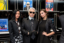 (L-R) Leigh Lezark, Karl Lagerfeld and Emily Ratajkowski during the opening of French illustrator Tiffany Cooper's exhibition of fake movie posters starring Karl Lagerfeld held at the Karl Lagerfeld boutique in St-Germain-des-Pres district in Paris, France on March 7, 2015. Photo by ABACAPRESS.COM