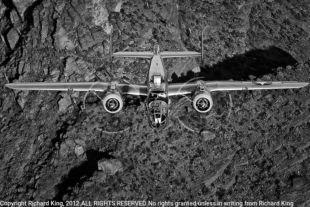B-25 Mitchell WWII Bomber aircraft black and white photograph taken from the air