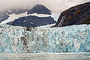 The Surprise glacier with the medial moraine running down the middle and brash ice floating in Harriman Fjord, near Whittier, Alaska. Surprise Glacier is the most active calving tidewater glacier in Prince William Sound.