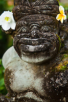 A Balinese togog is a decorative sculpted head, often decorated with flowers.  The faces and expressions taking form from Balinese folk tales and legends.
