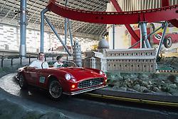 Visitors riding in model Ferrari car past famous Italian landmarks at Ferrari World in Abu Dhabi United Arab Emirates