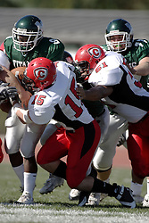 07 October 2006: Mike Kormelink (15) and Chris Coker (51) double up to tackle Marcus Dunlop. The Titans of Illinois Wesleyan University started off strong with a touchdown on the 2nd play from scrimmage in the game.  The Titans led most of the way, but failed to maintain the lead in the 4th quarter giving up the decision of this CCIW conference game to the Red Men of Carthage by a score of 31 - 28. Action was at Wilder Field on the campus of Illinois Wesleyan University in Bloomington Illinois.<br />