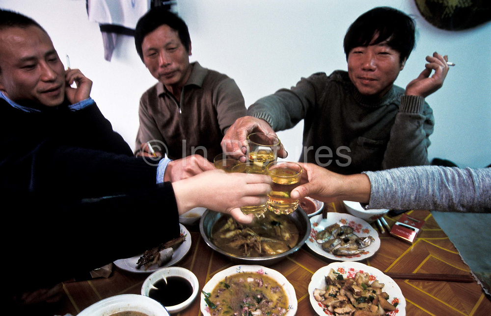 Fisherman Zhang Zhi Ping having lunch with his wife and friends