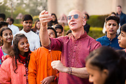 DELHI, INDIA – JANUARY 14, 2020: Amazon president Jeff Bezos flies homemade kites with local children as part of the annual festival of Uttarayan. Observed each year in the lunar month of Magha (January), the festival commemorates the end of winter and the anticipation of a fruitful harvest season, and is celebrated by flying kites.