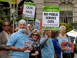 © Licensed to London News Pictures. 13/09/2013. Weston-super-Mare, Somerset, UK. A demonstration against cuts and privatisation of the NHS, outside the Royal Hotel in Weston-super-Mare during a visit for a private function by Health Secretary Jeremy Hunt who went in through a side entrance avoiding the protest.  The protesters say that Weston General Hospital is in danger of being franchised out to multi-nationals as the local health trust has suffered financial difficulties.  13 September 2013.<br /> Photo credit : Simon Chapman/LNP
