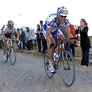 Gruson - Sunday, Apr 13 2008:  QUICK STEP's Tom BOONEN leads TEAM CSC's Fabian CANCELLARA towards the end of pavé secteur 3. Images from the 106th edition of the Paris Roubaix (1.HC) cycle race. Starting in Compiègne, north of Paris, the race finishes 259.5 km later in Roubaix. This year's edition includes 52.8 km on the famous pavé. (Photo by Peter Horrell / http://www.peterhorrell.com)
