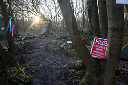 Wendover, UK. 10 January, 2020. Part of the newly-established Wendover Active Resistance Camp. Stop HS2 activists from around the UK established the camp in woodland outside Wendover on the proposed route for HS2 through the Chilterns AONB in response to requests for assistance from members of the local community opposed to the high speed rail link. The impact on the immediate area is expected to be even worse than initially expected, with not only two 500m viaducts and a 1km embankment to be constructed but also a Bentonite factory and 240-bed accommodation block.