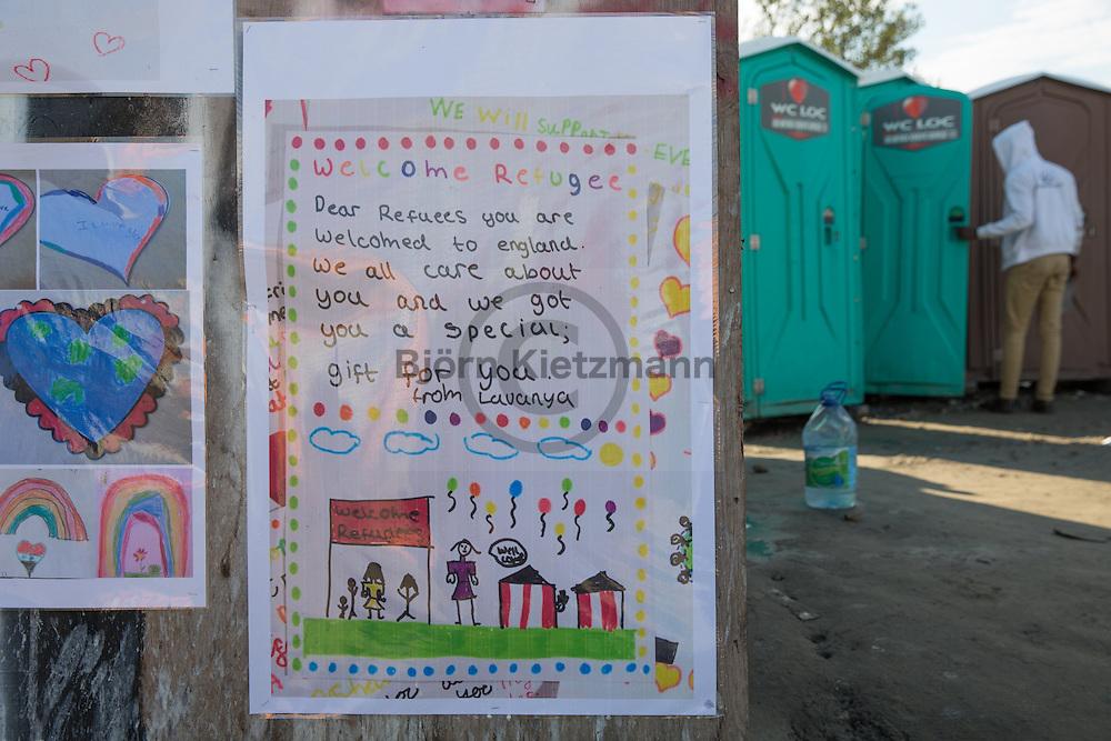 """Calais, Pas-de-Calais, France - 16.10.2016    <br />     <br /> Drawings of british school kids on a booth in the """"Jungle"""" refugee camp on the outskirts of the French city of Calais. Many thousands of migrants and refugees are waiting in some cases for years in the port city in the hope of being able to cross the English Channel to Britain. French authorities announced that they will shortly evict the camp where currently up to up to 10,000 people live.<br /> <br /> Zeichnungen von britischen Schulkindern an einer Bretterbude im """"Jungle"""" Fluechtlingscamp am Rande der franzoesischen Stadt Calais. Viele tausend Migranten und Fluechtlinge harren teilweise seit Jahren in der Hafenstadt aus in der Hoffnung den Aermelkanal nach Großbritannien ueberqueren zu koennen. Die franzoesischen Behoerden kuendigten an, dass sie das Camp, indem derzeit bis zu bis zu 10.000 Menschen leben Kürze raeumen werden. <br /> <br /> Photo: Bjoern Kietzmann"""