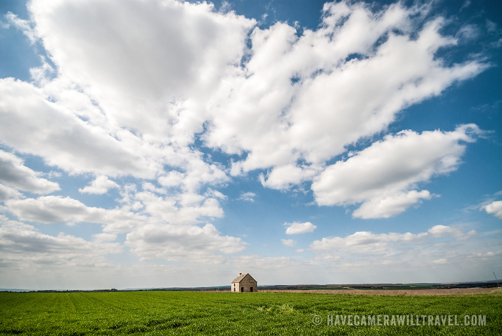 Wide-angle shot of a solitary, abandoned farm house in the French countryside near Chablis