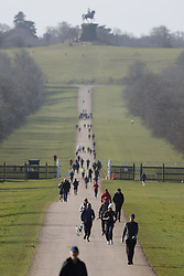 © Licensed to London News Pictures. 27/03/2021. Windsor, UK. People walk and run on The Long Walk leading to Windsor Castle in morning sunshine. Next week parts of the UK will see temperatures rise to more than 20C.  Photo credit: Peter Macdiarmid/LNP
