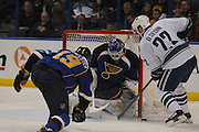 The puck bounces off St. Louis Blues goalie Brian Elliott (1) after a point-blank shot by Vancouver Canucks left wing Daniel Sedin (22) as St. Louis Blues defenseman Jay Bouwmeester (19, left) moves closer in second period action during a game between the Vancouver Canucks and the St. Louis Blues on Tuesday April 16, 2013 at the Scottrade Center in downtown St. Louis.