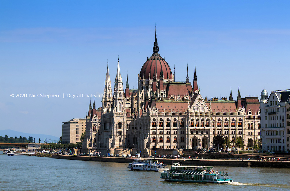Houses of Parliament in sunlight on the River Danube in Budapest, Hungary.
