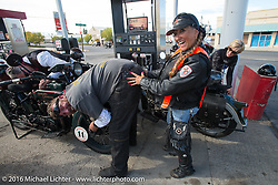 "Vicki Sanfelipo joking with Robert Gustavsson or ""Big Swede"" as he is fondly known, about how tall they are (and the difference between) during Stage 14 - (284 miles) of the Motorcycle Cannonball Cross-Country Endurance Run, which on this day ran from Meridian to Lewiston, Idaho, USA. Friday, September 19, 2014.  Photography ©2014 Michael Lichter."