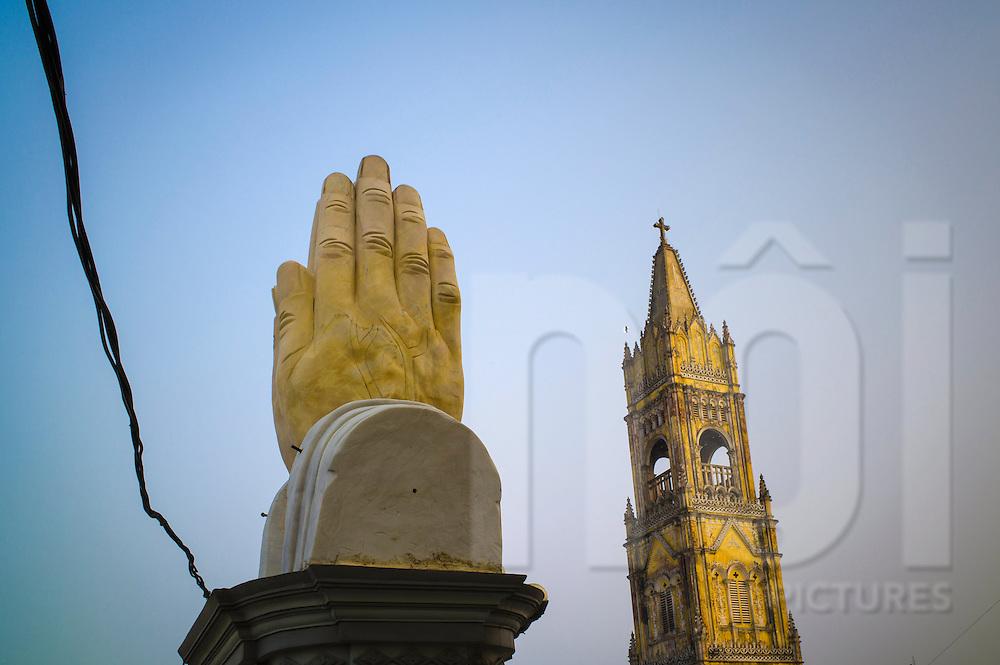 Praying hands statue in front of Lieu De Parish Church in Lieu De Town, Nghia Hung District, Nam Dinh Province, Vietnam, Southeast Asia