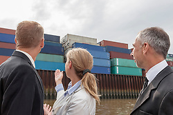 Businesswoman explaining about shipping business to her partners, Hamburg, Germany