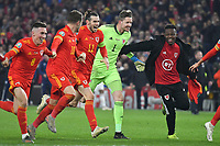 Football - 2019 / 2020 UEFA European Championships Qualifier - Group E: Wales vs. Hungary<br /> <br /> Wayne Hennessey of Wales. Gareth Bale of Wales , Aaron Ramsey of Wales celebrate Wales' victory & qualification for Euro 2020, at Cardiff City Stadium.<br /> <br /> COLORSPORT/WINSTON BYNORTH