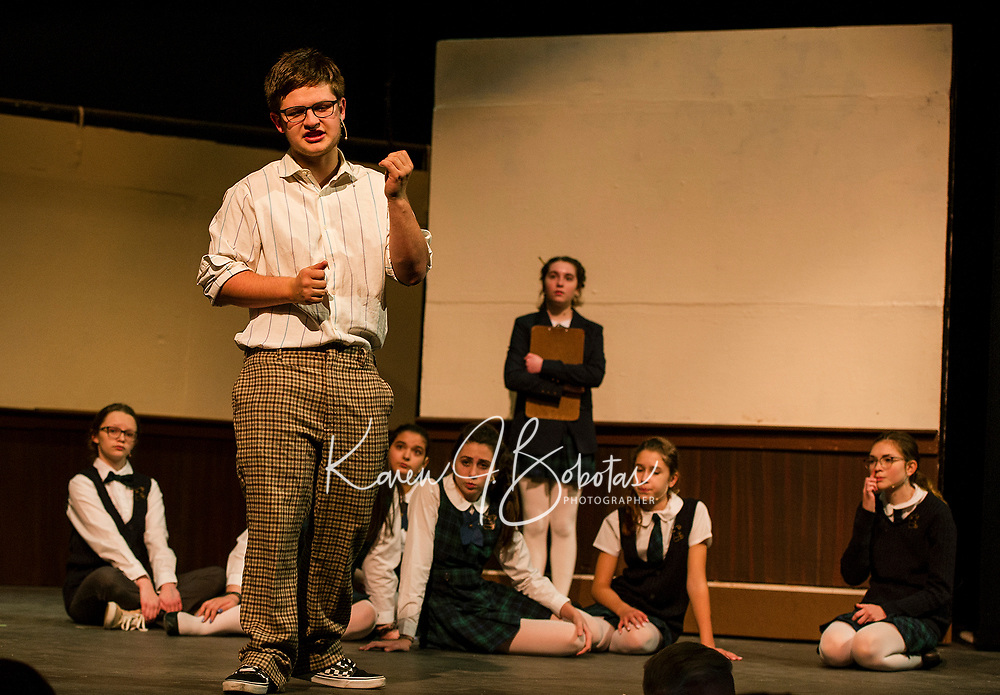 """""""Dewey Finn"""" Jonathan Buttrick convinces his students to be in a rock band during dress rehearsal for School of Rock at Gilford High School Tuesday evening.  (Karen Bobotas/for the Laconia Daily Sun)"""