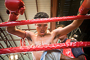 02 JULY 2006 - PHNOM PENH, CAMBODIA: A boxer gets a rubdown between rounds during a traditional Khmer boxing match in Phnom Penh, Cambodia. Khmer boxing is the same sport as Muay Thai (traditional Thai kick boxing) but because off animosity between Thailand and Cambodia it is called Khmer Boxing in Cambodia. The Cambodians claim to have invented the sport, which is also practiced in Laos and Burma. Photo by Jack Kurtz