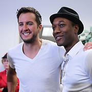 Musicians Luke Bryan (l) and Aloe Blacc pose in the media room prior to the 56th Annual NASCAR Daytona 500 race at Daytona International Speedway on Sunday, February 23, 2014 in Daytona Beach, Florida.  Sinise is the Grand Marshal for the race. (AP Photo/Alex Menendez)