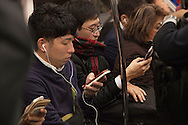 Tokyo, Japan - November 9, 2016: Commuters in central Tokyo read the news about Donald Trump's victory in the the US presidential election which came as a shock to most Japanese. Financial markets around the world went into a tailspin as did currency exchange rates. In Japan the US dollar dropped rapidly from around 105 yen to a dollar to 101 yen by midday. The Nikkei 225 index also nose-dived by 5.36 ending down 919.84 points from the previous at 16,251.54. (Torin Boyd/Polaris).