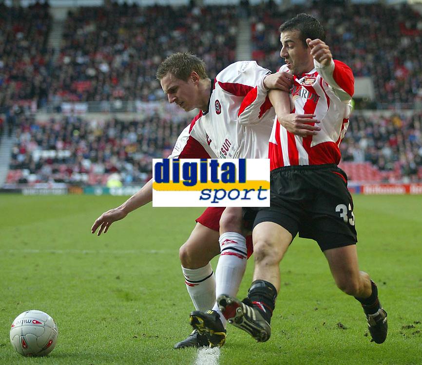 Photo. Andrew Unwin.<br /> Sunderland v Sheffield United, FA Cup Sixth Round, Stadium of Light, Sunderland 07/03/2004.<br /> Sunderland's Julio Arca (r) tussles with Sheffield United's Phil Jagielka (l).