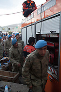Turkish Jandarma and police stand guard over families and friends outside the rescue shaft at Soma mine, western Turkey. At least 238 miners have been declared dead in the disaster when an electrical fault caused an underground explosion.