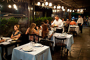 Women sitting down for dinner being served by a waiter, Palermo, Buenos Aires, Federal District, Argentina.