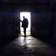 A visitor entering one of the former prisoner barracks at the Auschwitz-Birkenau Nazi concentration camp close to Krakow in Poland. It is estimated that between 1.1 and 1.5 million Jews, Poles, Roma and others were killed in Auschwitz during the Holocaust between 1940-1945. The 27th of January 2015 is the 70th anniversary of the liberation of Auschwitz. #humanrights #documentary #photojournalism #panospictures #panos #auschwitz #poland #krakow #concentrationcamp #genocide #thirdreich #history #konzentrationslager #documentary#easterneurope #politics #prison #museum#people #prison #memorial #70th #anniversary