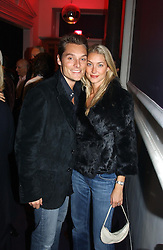 MR & MRS SEB BISHOP she was model Heidi Wichlinski former girlfriend of racing driver David Coulthard at a party hosted by jeweller Theo Fennell and Dominique Heriard Dubreuil of Remy Martin fine Champagne Cognac entitles 'Hot Ice' held at 35 Belgrave Square, London, W1 on 26th October 2004.<br /><br />NON EXCLUSIVE - WORLD RIGHTS