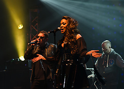 © Licensed to London News Pictures. 10/05/2012. London, UK.  Happy Mondays perform live at O2 Academy Brixton.  In picture L to R - Shaun Ryder (vocals), Rowetta Satchell (vocals), keyboards (Paul Davies).  Photo credit : Richard Isaac/LNP