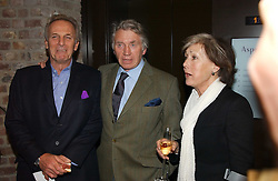 Left to right, MARK SHAND brother HRH The Duchess of Cornwall, photograher DON MCCULLIN and PATTI PALMER-TOMKINSON at a party to celebrate the publication of 'Last Voyage of The Valentina' by Santa Montefiore at Asprey, 169 New Bond Street, London W1 on 12th April 2005.<br />