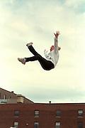 Gymnastic bouncer age 17 at Cinco de Mayo festival.  St Paul Minnesota USA