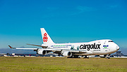 A Cargolux Boeing 747-4HQF (ER) taxis by in the brilliant sunshine at Atlanta's Hartsfield -Jackson International Airport.