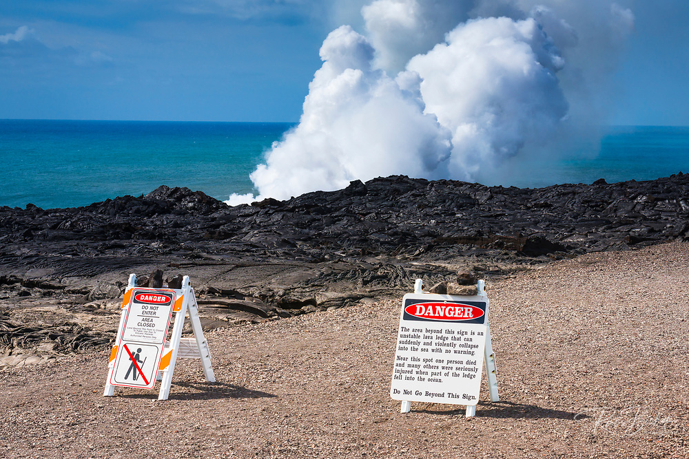 Warning signs at the Kamokuna lava ocean entry, Hawaii Volcanoes National Park, Hawaii USA