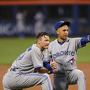 Josh Donaldson, (left), Toronto Blue Jays and team mate Ryan Goins during the New York Mets Vs Toronto Blue Jays MLB regular season baseball game at Citi Field, Queens, New York. USA. 15th June 2015. Photo Tim Clayton