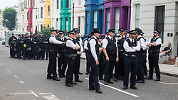 London, August 30th 2015. Hundtreds of police officers are deployed to manage the vast crowds as revellers enjoy day one of the Notting Hill Carnival.