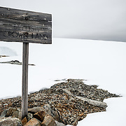 An old wooden sign proclaims British Crown Land near historic Wordie House in Antarctica. Originally known as Base F and later renamed after James Wordie, chief scientist on Ernest Shackleton's major Antarctic expedition, Wordie House dates to the mid-1940s. It was one of a handful of bases built by the British as part of a secret World War II mission codenamed Operation Tabarin. The house is preserved intact and stands near Vernadsky Research Base in the Argentine Islands in Antarctica.