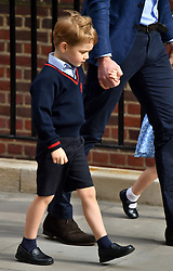 Prince George holds his fathers hand as he arrives to meet his newborn brother at the Lindo Wing at St Mary's Hospital in Paddington, London.