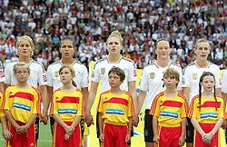 30.06.2011, Commerzbank Arena, Frankfurt, GER, FIFA Women Worldcup 2011, Gruppe A, Deutschland (GER) vs. Nigeria (NGA), im Bild .die deutsche Mannschaft , v.l.n.r. Saskia Bartusiak , Celia Okoyino Da Mbabi , Kim Kulig , Nadine Behringer , Simone Laudehr (alle GER) fassen sich bei der Nationalhymne an den Händen .// during the FIFA Women Worldcup 2011, Pool A, Germany vs Nigeria on 2011/06/30, Commerzbank Arena, Frankfurt, Germany.  EXPA Pictures © 2011, PhotoCredit: EXPA/ nph/  Karina Hessland       ****** out of GER / CRO  / BEL ******